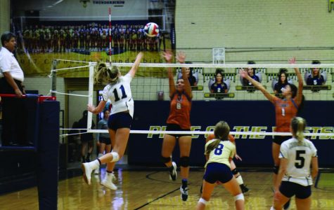Senior Cambell Bowden hitting the ball over the net