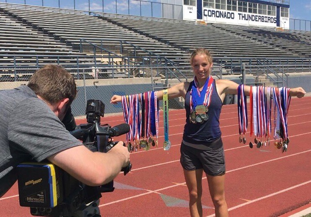 Jaeger showcases medals awarded throughout her high school career.