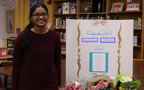 Srila Muthyala, winner of the PTSA Reflection's Literature Contest, poses by a poster with her original poem during the ceremony.