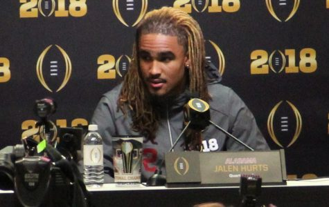 Hurts answers questions at media day for the College Football Playoff in 2018.
