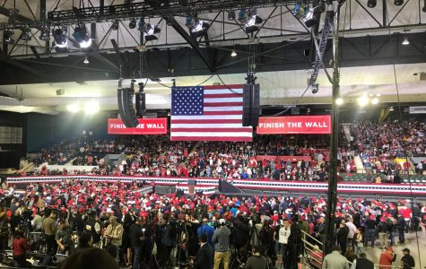 Attendees wait to hear President Trump address the audience.