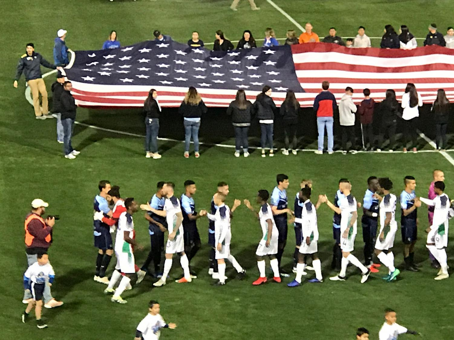 Locomotive+FC+and+OKC+Energy+FC+shake+hands+before+the+match+begins.+