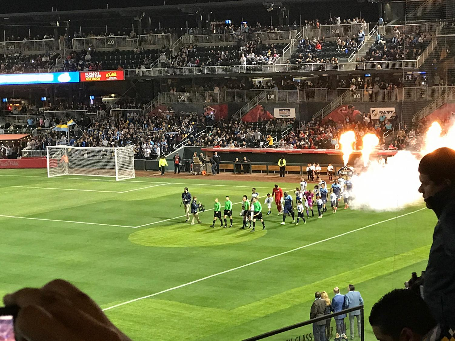 Locomotive+FC+and+OKC+FC+Energy+walk+out+onto+the+field+for+the+inaugural+opener.+
