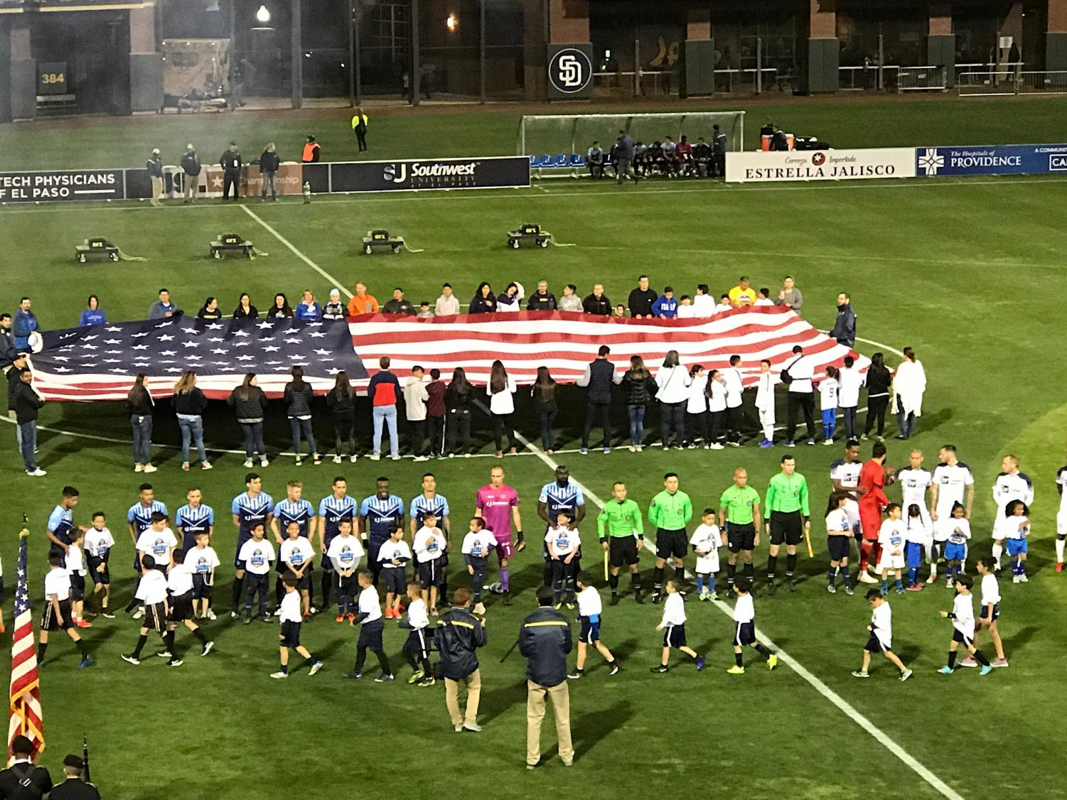 Locomotive+FC+and+OKC+Energy+FC+line+up+with+referees+for+the+national+anthem.+