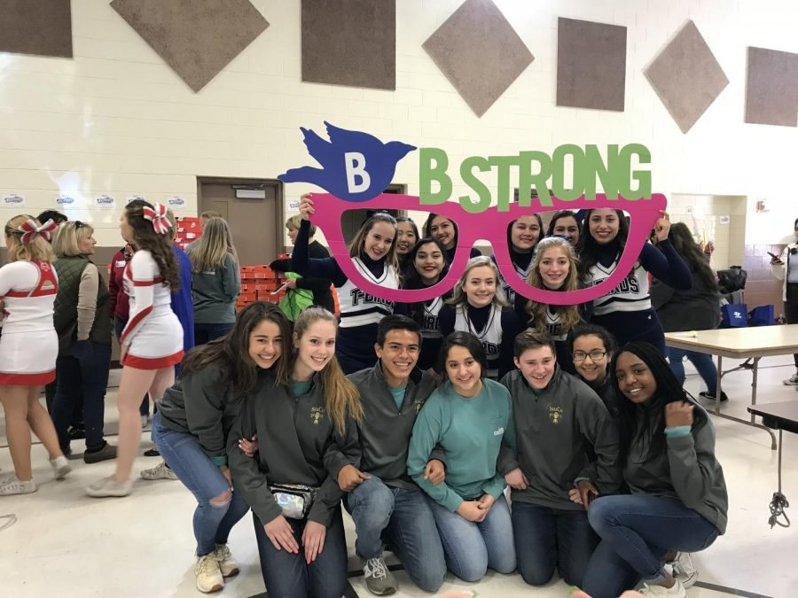 Coronado's student council and cheerleading team helped distribute shoes at Cooley Elementary.