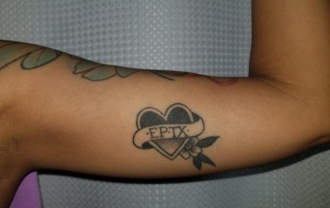 Tattoos can convey a wide variety of messages, such as this El Paso heart tattoo on a woman's bicep.