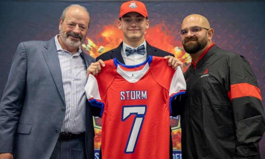Davis Burns poses with former mayor Oscar Leeser and Joseph Vasquez of BSN Sports after being selected in the draft.