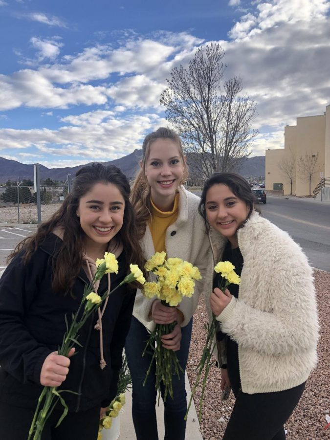 Student Council officers passed out flowers on the last day of the week.