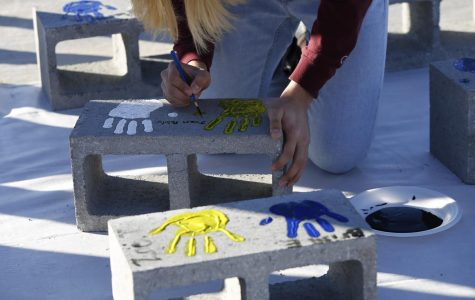 The field house, which was dedicated on Jan. 24, will bear the handprints of the students and coaches in outside sports.