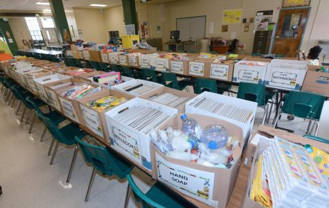 Public elementary school receives aid from Medical Battalion Soldiers due to a shortage of supplies.