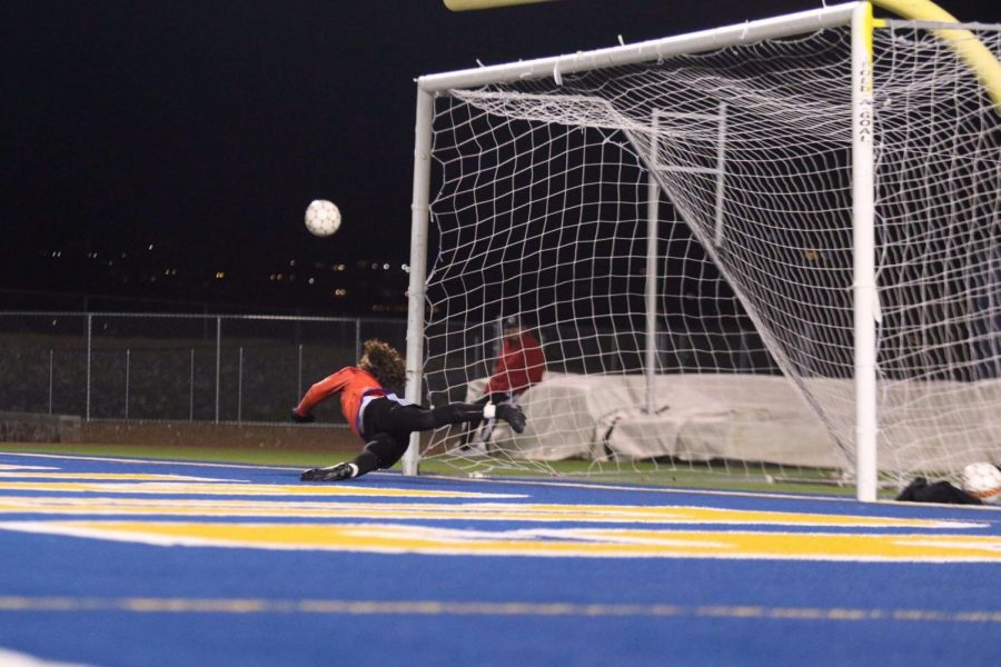 Becerra dives to save a goal in penalty kicks against a strong Pebble Hills team. The team would win the game in penalties.