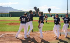 Team celebrates with senior Jorge Cuevas after he hits homerun earlier this year, prior to the canceling of the season.