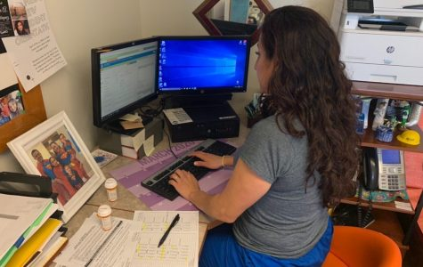 Nurse Karla Ortiz types medical information into her computer as part of the record-keeping process.
